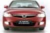 Honda Civic Hybryda - przód - reflektory włączone